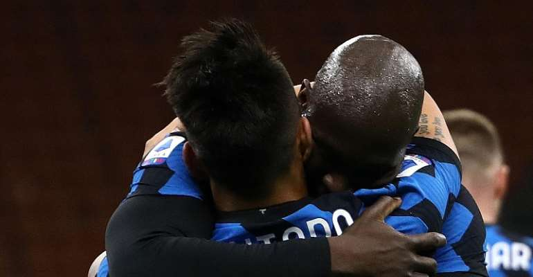 Lautaro Martinez of Internazionale celebrates with team mate Romelu Lukaku after scoring their side's second goal during the Serie A match between FC Internazionale and US Sassuolo at Stadio Giuseppe Meazza on April 07, 2021 in Milan, Italy.  Image credit: Getty Images