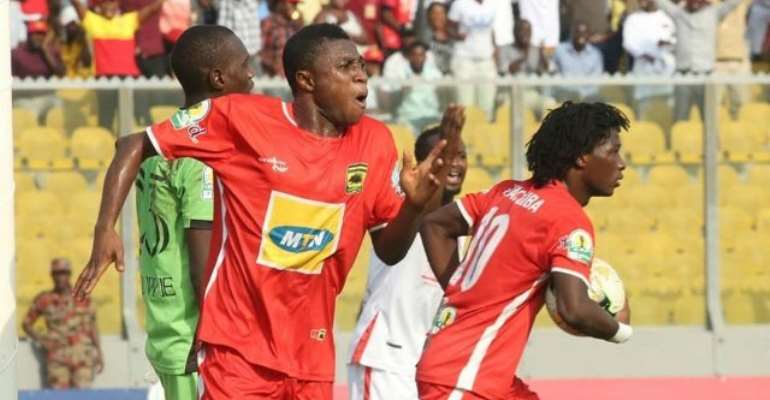 Emmanuel Gyamfi and Songne Yacouba (holding the ball)