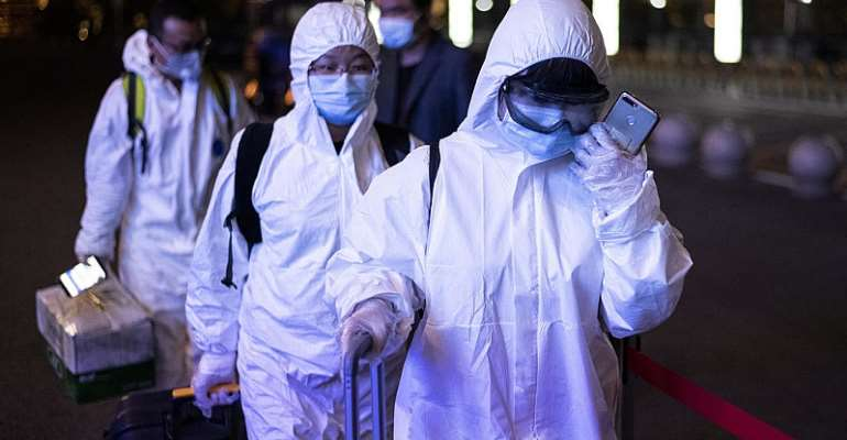 Wuhan emerges from coronavirus lockdown as cases rise in China's north