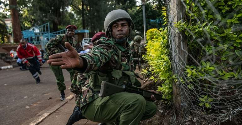 A Kenyan soldier urges people to take cover during the terror attack on the Dusit Hotel complex in 2018. - Source: Andrew Renneisen/GettyImages