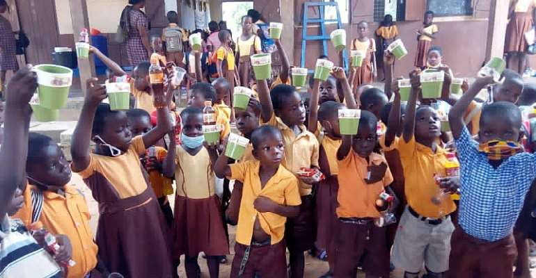 Another Basic School Teacher donates drinking cups to pupils
