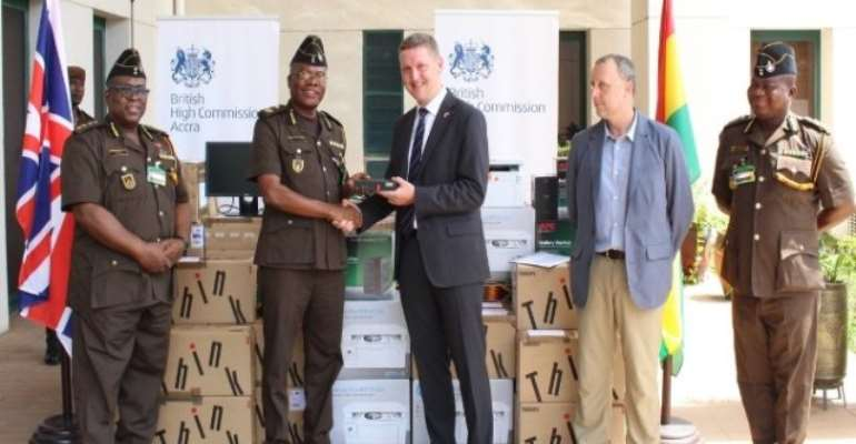 British High Commissioner to Ghana, Iain Walker, making the donation
