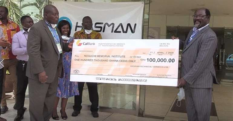 From Left Mr William Andoh Wood, MD Hasman Technical Services Presenting The Cheque To Professor Annan, Director, Noguchi Memorial Institute