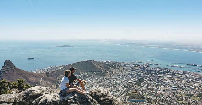 A couple taking in the view from Table Mountain, Cape Town. - Source: Getty Images