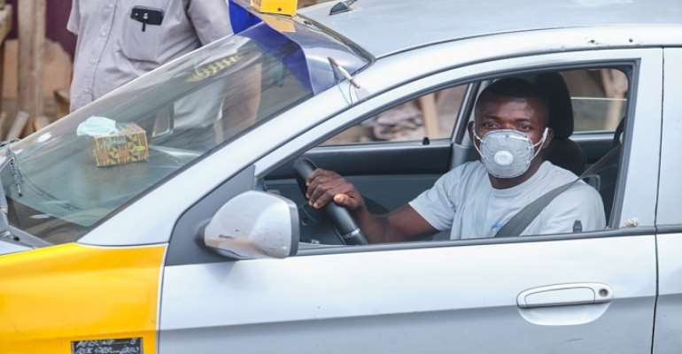 Yilo Krobo: Police Commander, Team Enforce Mandatory Face Mask Wearing On Taxi Drivers