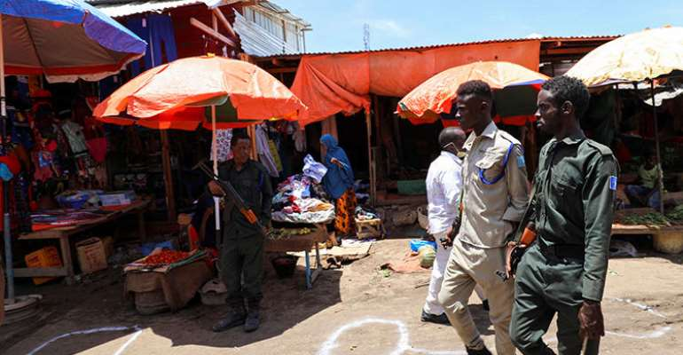 Police officers are seen in Mogadishu, Somalia, on April 16, 2020. Somali authorities have been holding journalist Mohamed Abdiwahab Nuur incommunicado since early March. (Reuters/Feisal Omar)