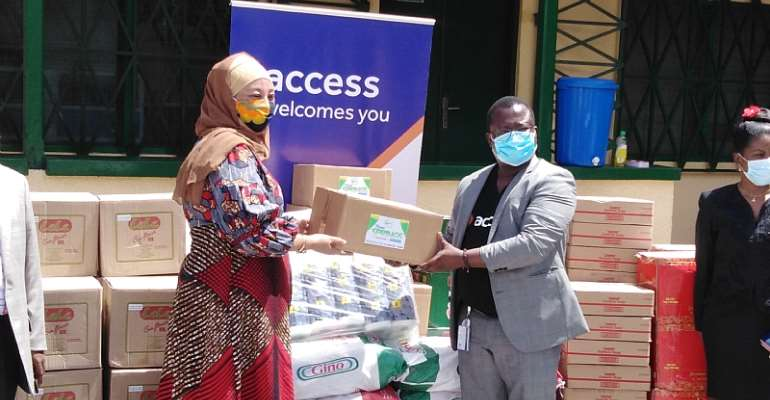 Hajia Salma (left) receiving the items from Mr. Jude Atubigah of the Access Bank