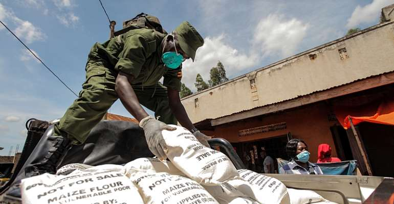A military officer distributes maize flour in Kampala, Uganda, where the urban poor have been affected by the lockdown.  - Source: Hajarah Nalwadda/Xinhua via GettyImages