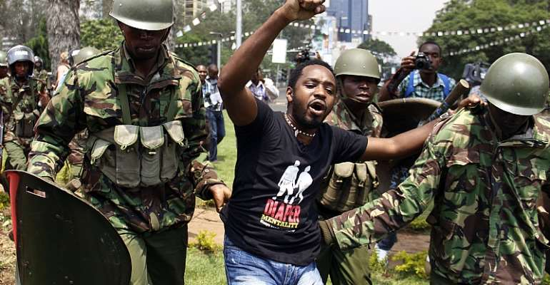 Kenyan activist Boniface Mwangi is arrested during a protest in Nairobi in 2014.  - Source: AFP via Getty Images