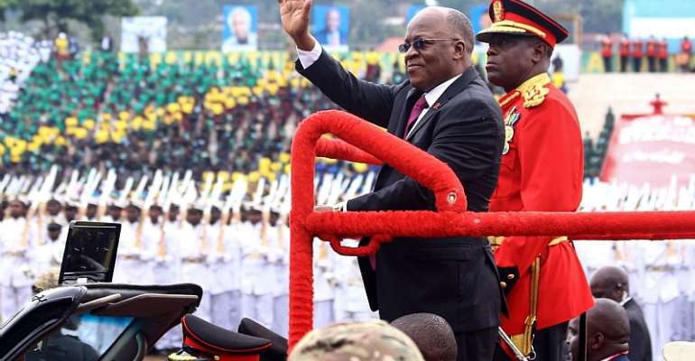 Tanzanian President John Magufuli waves as he attends a ceremony marking the country's 58th independence anniversary in 2019. - Source: Stringer/AFP via GettyImages