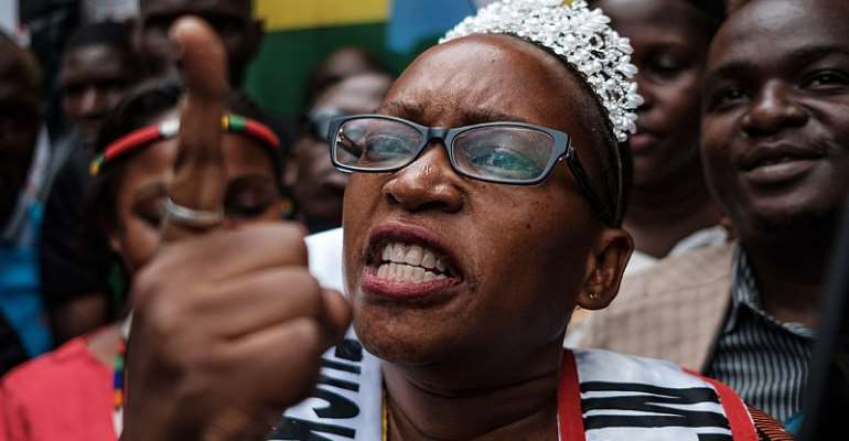 Ugandan activist and writer Stella Nyanzi outside a Kampala court after a ruling in her favour against President Yoweri Museveni  - Source: Sumy Sadurni/AFP via GettyImages