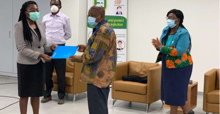 Acting WR, Dr Neema Rusibamayila Kimambo, Handing Over The Official Letter To The Minister Of Health, Hon. Kwaku Agyemang-Manu