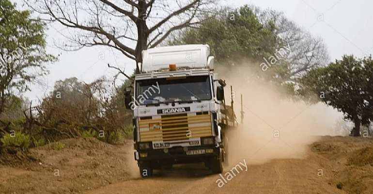 some vehicles on dusty road at Gambaga in North East