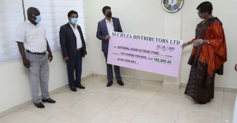 Sucryza Distributors Donate Ghc100,000 To Covid-19 Trust Fund