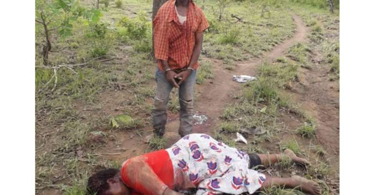 Suspect Yikatey Somatey with the lifeless body of the deceased in the bush at Sawla Tuna
