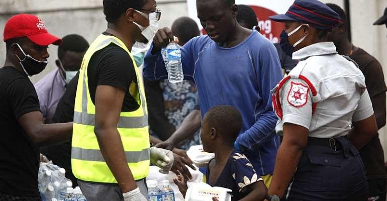 People receiving food handouts in Lagos, Nigeria. - Source: AAP