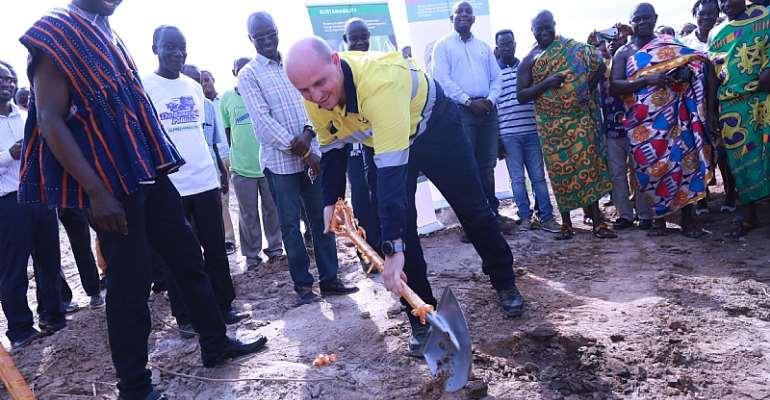 Bernard Wessels, GM of Ahafo Mine, cuts sod to begin constructon