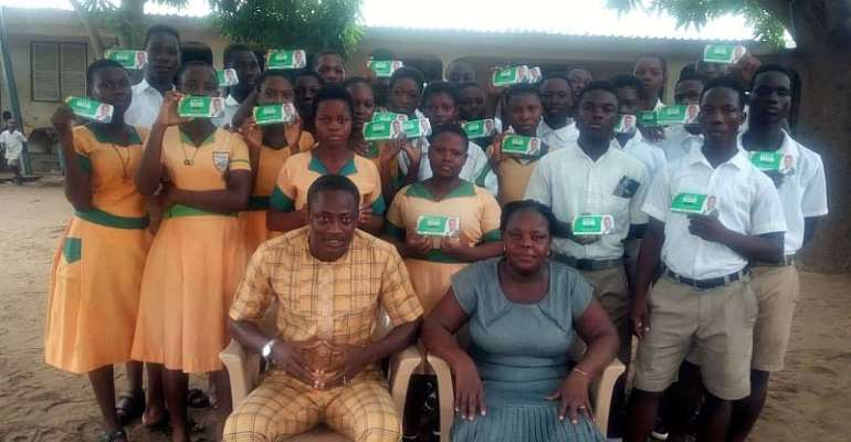Mr Bill Ocloo with some BECE candidates