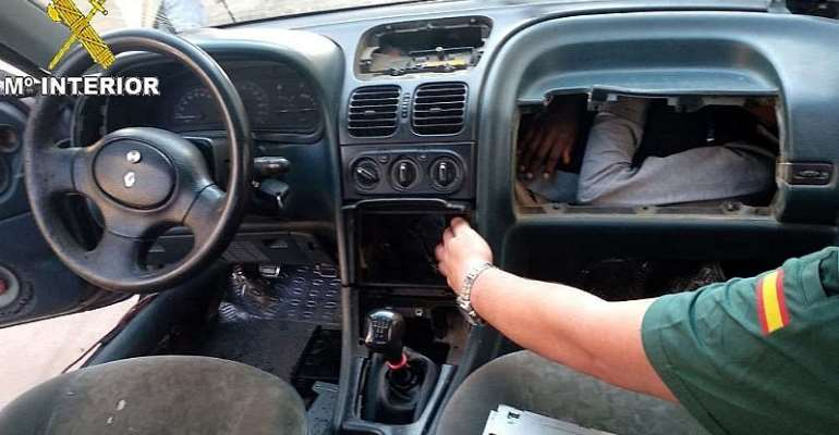 When the Spanish police opened the glove compartment, they found an illegal immigrant inside