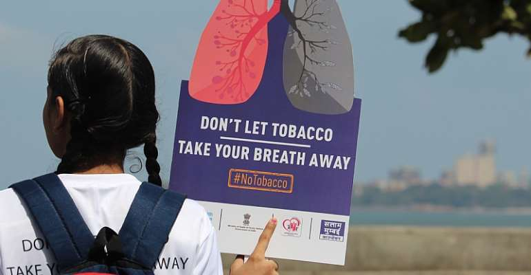 A girl holds a placard during a rally to create awareness about the effect of tobacco. - Source: Himanshu Bhatt/NurPhoto via Getty Images