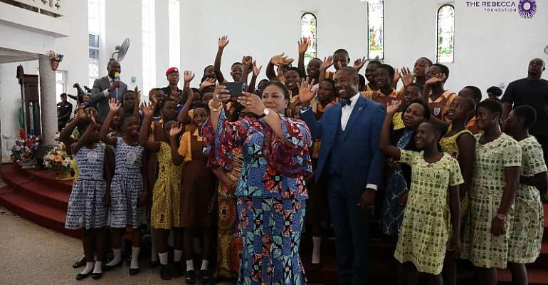 Mrs. Akufo Addo taking a selfie with the girls and the MP for Ledzokuku