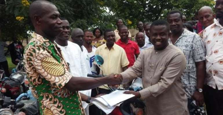 Picture on extremely left shows a section of the motorbikes whilst documentations on them are handled over to Presiding Member by MP for Tano South Constituency.