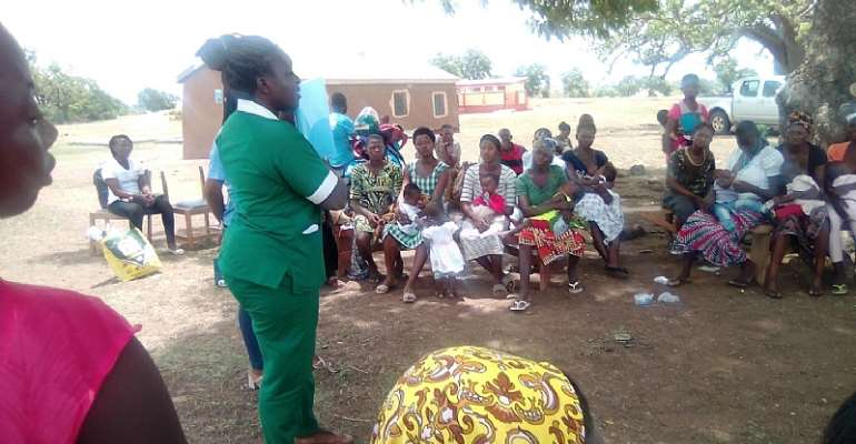 Community members being schooled  on Sexual Reproductive Health on the Menstrual Hygiene Day held in communities in UER