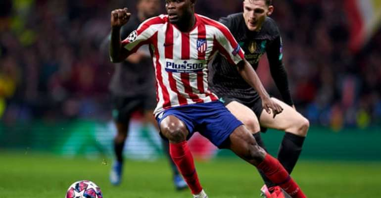 Thomas Partey in action against Liverpool at Anfield in the Uefa Champions League