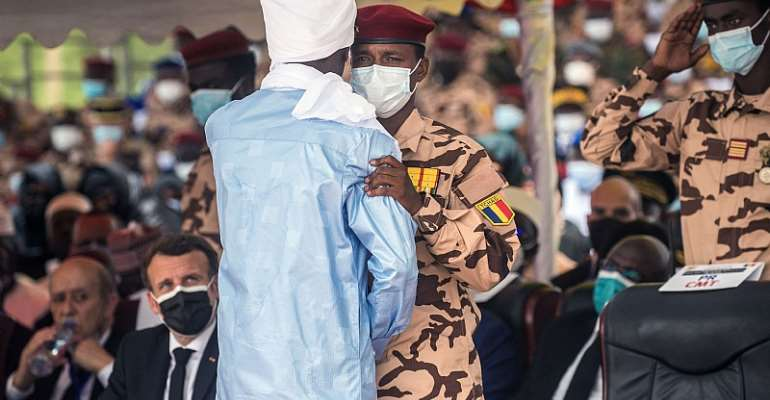Mahamat Idriss Deby, right, greets his brother Zakaria during the state funeral for their father Chadian President Idriss Deby.  - Source: Christophe Petit/AFP via Getty Images