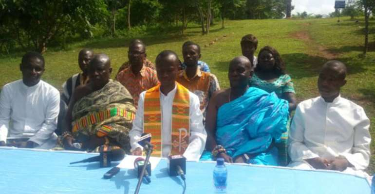 Rev Fr Paintsil addressing the media as other church members look on