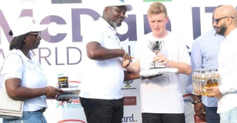 Ryan James Storrie Receiving his trophy after defeating Benjamin Lock
