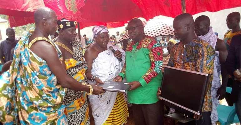 Nana Konadu, Besoro Queen and Nana Oteng Ofori presenting the items to education Director