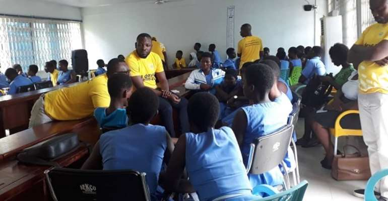Some MTN officials interacting with students of Sekondi College