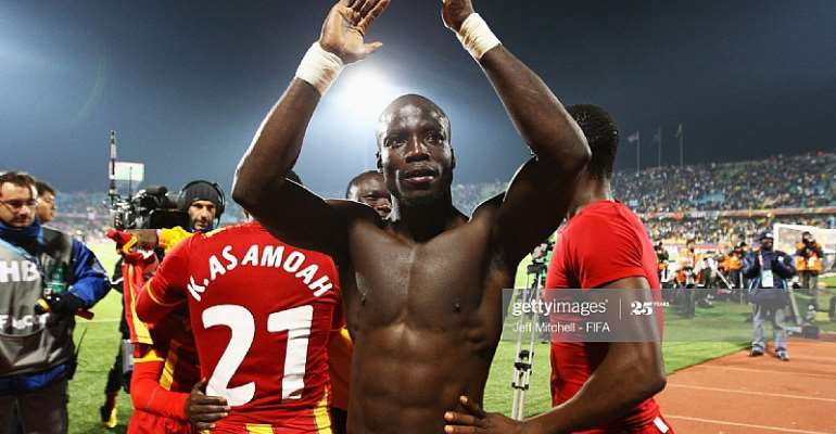 RUSTENBURG, SOUTH AFRICA - JUNE 26: Stephen Appiah of Ghana celebrates progress to the quarter finals after the 2010 FIFA World Cup South Africa Round of Sixteen match between USA and Ghana at Royal Bafokeng Stadium on June 26, 2010 in Rustenburg, South Africa. (Photo by Jeff Mitchell - FIFA/FIFA via Getty Images)