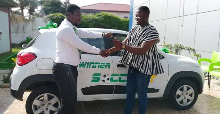 Mr. Kpiasi Sulley Batong receiving his brand new Renault KWID from SoccaBet