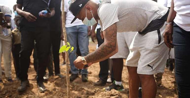 Black Stars captain, Andre Ayew planting a tree