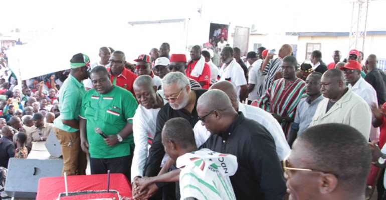 NDC Bribes Rawlings With Cake