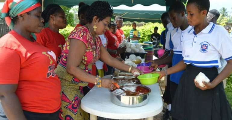 Queenstar Pokuah Sawyeer (second left) serving meals to the candidates