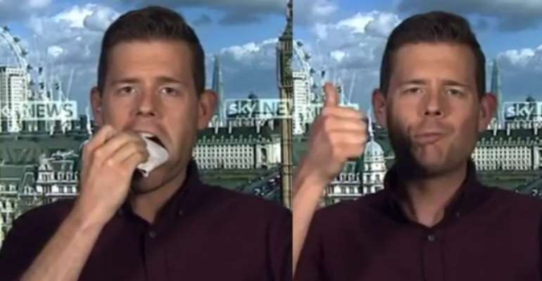 Political pundit eats book on live TV after going wrong on UK poll results