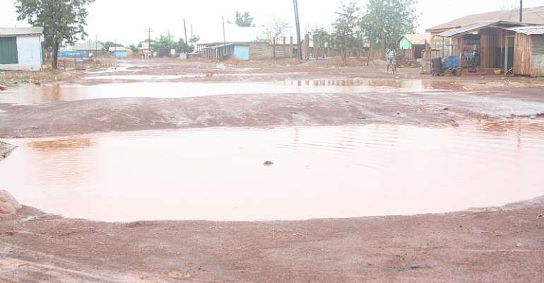 "A Choice Between Rescue And Recovery From The Wrath Of 5ft-Deep Twin ""Dams"" In The Middle Of A Major Road In The Tamale Metro"