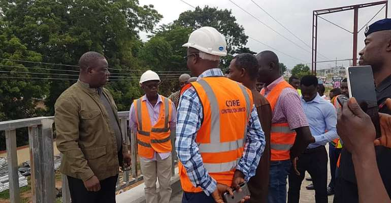 RoadsMinister Inspects Madina-Adenta Footbridge Construction Site