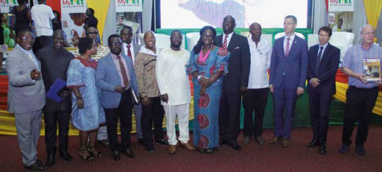 Gifty Twum Ampofo (middle) with COTVET executive and other dignitaries