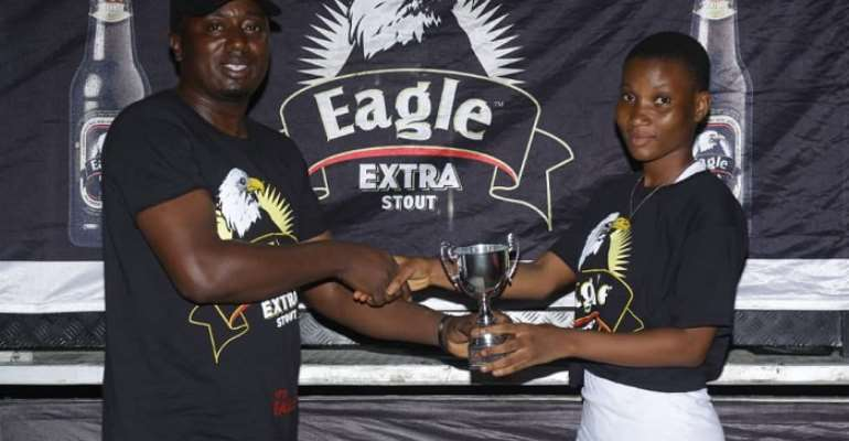 FLASHBACK: Brand Manager at Eagle Extra Stout, John Akado (L), making a presentation to Grace Commey, a combatant in a previous even
