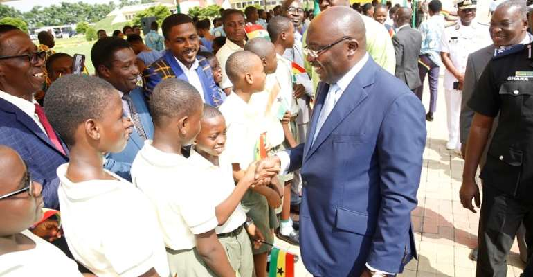 Vice President Dr. Bawumia exchanging pleasantries with some pupils after the function