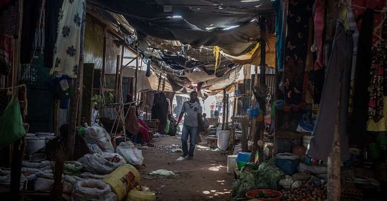 A man seen walking through a market in Dadaab refugee camp.  More than 200,000 refugees live there.  - Source: Sally Hayden/SOPA Images/LightRocket via Getty Images