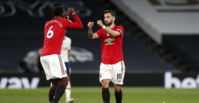 Bruno Fernandes of Manchester United celebrates after scoring his sides first goal with teammate Paul Pogba of Manchester United during the Premier League match between Tottenham Hotspur and Manchester United at Tottenham Hotspur Stadium on June 19, 2020  Image credit: Getty Images