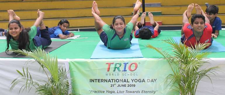 Parents, Students Join International Yoga Day At TRIO World School