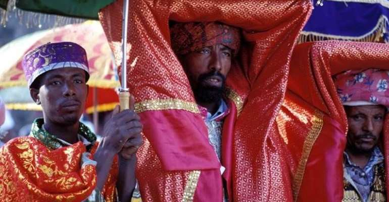Orthodox priest carries a covered tabot in a ceremony in Gondar, Ethiopia. Photo: Jialiang Gao https://commons.wikimedia.