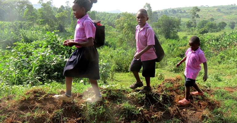 Children make their way to school in Fort Portal, Uganda. - Source: Shutterstock