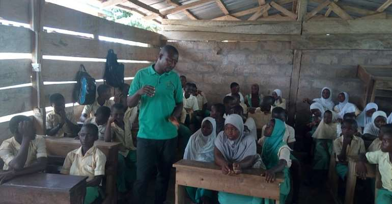 Mr Tetteh, educating the students about the environment
